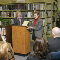 Penny Petrone and Anne Deighton by the lectern in Northern Studies Resource Center