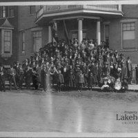 Men and women on the steps of the Finn Hall, circa 1910